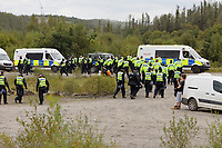 Pictured: Police officers leave the site. Monday 31 August 2020<br /> Re: Around 70 South Wales Police officers executed a dispersal order at the site of an illegal rave party, where they confiscated sound gear used by the organisers in woods near the village of Banwen, in south Wales, UK.