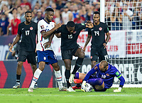 NASHVILLE, TN - SEPTEMBER 5: Jordan Pefok #19 of the United States is defended by Doneil Henry #15 as Milan Borjan #18 of Canada makes a save during a game between Canada and USMNT at Nissan Stadium on September 5, 2021 in Nashville, Tennessee.