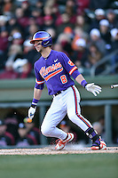 Clemson Tigers third baseman Weston Wilson (8) swings at a pitch during a game against the South Carolina Gamecocks at Fluor Field February 28, 2015 in Greenville, South Carolina. The Gamecocks defeated the Tigers 4-1. (Tony Farlow/Four Seam Images)