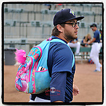 Pitcher Anthony Kay (18) of the Columbia Fireflies carries the supplies backpack for the bullpen before in a game at Spirit Communications Park in Columbia, South Carolina. (Tom Priddy/Four Seam Images) #MiLB