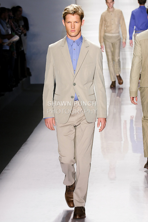 Model walks the runway in an outfit by Elie Tahari, for the Elie Tahari Spring 2011 runway fashion show, during Mercedes-Benz Fashion Week, September 14, 2010.
