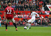 Pictured: (L-R) Paul Scholes, Jonathan de Guzman. <br /> Sunday 12 May 2013<br /> Re: Barclay's Premier League, Manchester City FC v Swansea City FC at the Old Trafford Stadium, Manchester.
