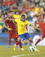 Brazil substitute midfielder Lucas Moura (7) on the attack.  In an international friendly, Brazil (yellow/blue) defeated Portugal (red), 3-1, at Gillette Stadium on September 10, 2013.