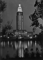 Louisiana State capitol, Baton Rouge, Louisiana. Tower lights at night, reflected in lake. Sept 1932.<br /> <br /> Photo by Gottscho-Schleisner