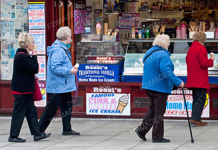 Older people shopping and enjoying a day out in Southport England.