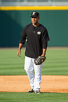 Micah Johnson (3) of the Charlotte Knights during infield practice prior to the game against the Norfolk Tides at BB&T Ballpark on May 21, 2014 in Charlotte, North Carolina.  The Tides defeated the Knights 10-3.  (Brian Westerholt/Four Seam Images)