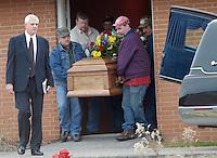 Pallbearers carry the casket for Sago miner Jesse Jones Sunday, Jan. 8, 2006, in Buckhannon, WV Jones is one of 12 miners killed in the Sago mine explosion. At right is Jones' brother, Owen Jones. (Gary Gardiner/EyePush Newsphotos)<br />