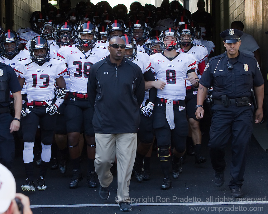 Gardner-Webb head coach Ron Dickerson Jr. leads his team onto the field. Also shown are Kamar Morrison (13), Chad Geter (38) and quarterback Lucas Beatty (8).The Pitt Panthers defeated the Gardner-Webb Runnin Bulldogs 55-10 at Heinz Field, Pittsburgh PA on September 22, 2012..