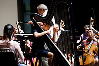 Valerio Lisci from Italy performs during an orchestra rehearsal for the Final Stage concert at the 11th USA International Harp Competition at Indiana University in Bloomington, Indiana on Friday, July 12, 2019. (Photo by James Brosher)