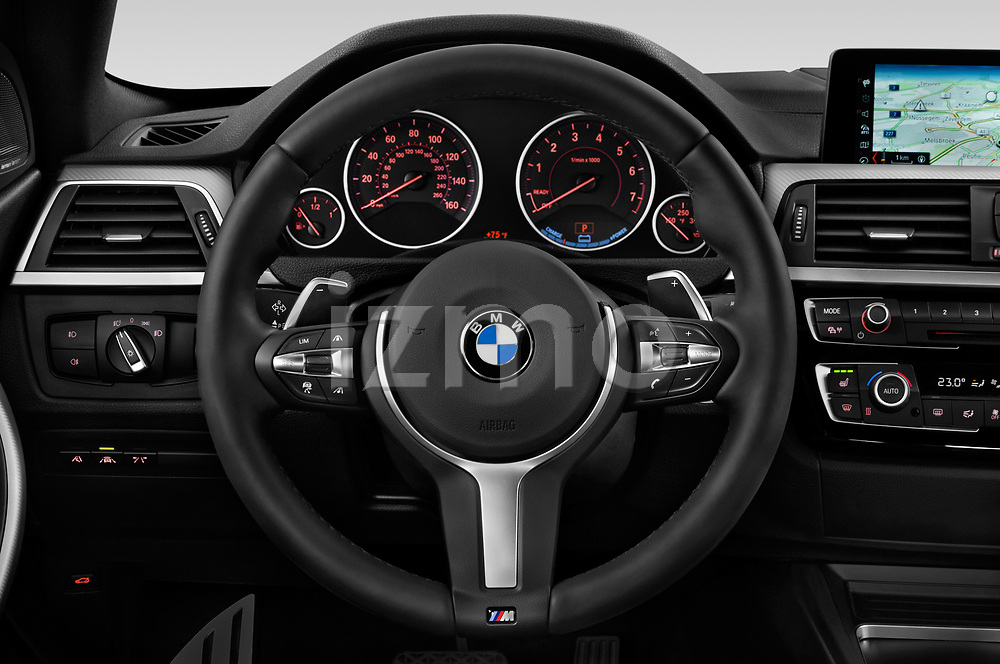 Car pictures of steering wheel view of a 2018 BMW 4 Series Gran Coupe 440i M Sport 5 Door Hatchback