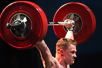 10 MAY 2014 - COVENTRY, GBR - Adam Mattiussi attempts to hold a lift during the men's 77kg A category round at the British 2014 Senior Weightlifting Championships and final 2014 Commonwealth Games qualifying event round at the Ricoh Arena in Coventry, Great Britain. Mattiussi's combined total for the event of 286kg makes him eligible for selection for the England team for the Commonwealth Games in Glasgow (PHOTO COPYRIGHT © 2014 NIGEL FARROW, ALL RIGHTS RESERVED)