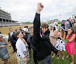 An associate of John Velasquez celebrate's with the winning rider's son Michael Patrick after Animal Kingdom, trained by Graham Motion, won the 137th running of the Kentucky Derby at Churchill Downs in Louisville, Kentucky on May 7, 2011.