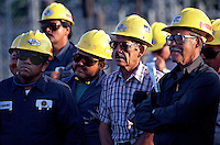 Group of ethnic railroad workers attending a safety meeting in the rail yard. Group of ethnic Railroad workers. Houston Texas.