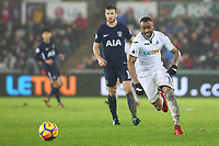 Jordan Ayew of Swansea City chases after the loose ball during the Premier League match between Swansea City and Tottenham Hotspur at the Liberty Stadium, Swansea, Wales, UK. Tuesday 02 January 2018