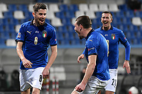 Jorge Luiz Frello Filho Jorginho of Italy celebrates with Andrea Belotti and Federico Bernardeschi after scoring the goal of 1-0 during the Uefa Nation League Group Stage A1 football match between Italy and Poland at Citta del Tricolore Stadium in Reggio Emilia (Italy), November, 15, 2020. Photo Andrea Staccioli / Insidefoto