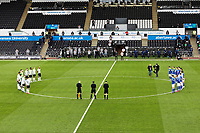 Swansea and Cardiff players observe a minute's silence before kick off during the Sky Bet Championship match between Swansea City and Cardiff City at the Liberty Stadium, Swansea, Wales, UK. Saturday 20 March 2021