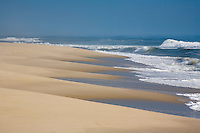 Incoming tide, sculpting the beach, New Jersey