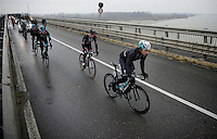 Mark Reshaw (AUS/Ettix-Quickstep) crossing the Po river<br /> <br /> 106th Milano - San Remo 2015