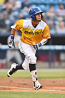 Beer City Tourists center fielder Manny Melendez (19) runs to first base during a game against the Lakewood BlueClaws at McCormick Field on June 1, 2017 in Asheville, North Carolina. The Tourists defeated the BlueClaws 8-5. (Tony Farlow/Four Seam Images)