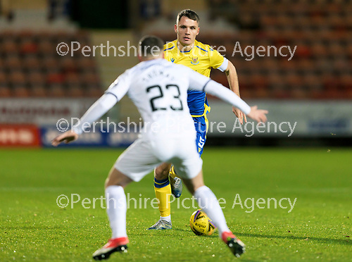 Dunfermline v St Johnstone…15.12.20   East End Park      BetFred Cup<br />Jason Kerr runs at Dominic Thomas<br />Picture by Graeme Hart.<br />Copyright Perthshire Picture Agency<br />Tel: 01738 623350  Mobile: 07990 594431