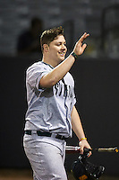 Siena Saints pinch hitter Nico Ramos (44) high fives teammates after hitting a home run during a game against the UCF Knights on February 17, 2017 at UCF Baseball Complex in Orlando, Florida.  UCF defeated Siena 17-6.  (Mike Janes/Four Seam Images)