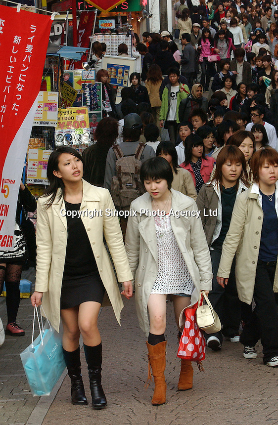 People out shopping in the Harajuku district of Tokyo, Japan..
