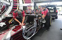 Jun. 17, 2011; Bristol, TN, USA: Crew members work on the car of NHRA top fuel driver Larry Dixon during qualifying for the Thunder Valley Nationals at Bristol Dragway. Mandatory Credit: Mark J. Rebilas-