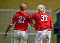 15 September 2019: Retired Major League Baseball and now Burlington Cardinal pitcher Bill Lee (37) consoles his teammate pitcher after a playoff game against the Waterbury Warthogs at Burlington High School in Burlington, Vermont. The Warthogs edged out the Cardinals 2-1 in post season play. Mandatory Credit: Ed Wolfstein Photo *** RAW (NEF) Image File Available ***