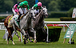 ELMONT, NY - JUNE 09: Disco Partner #5, ridden by Irad Ortiz, Jr.,  out duels #4, Conquest Tsunami to win the Jaipur Invitational Stakes on Belmont Stakes Day at Belmont Park on June 9, 2018 in Elmont, New York. (Photo by Kazushi Ishida/Eclipse Sportswire/Getty Images)