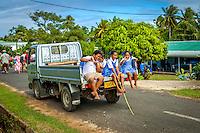 "Kids making ""shaka"" and ""thumbs up"" signs at the celebration of Makirau Haurua's investiture with the Teurukura Ariki title, Aitutaki Island, Cook Islands."
