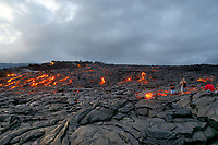 Hikers, Sunset, Large Pahoehoe lava flow in Royal Gardens subdivision, Kilauea volcano, east of Hawaii, USA Volcanoes National Park, Big Island of Hawaii, USA