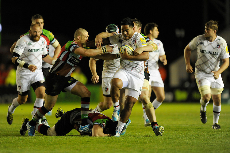 Manusamoa Tuilagi of Leicester Tigers is tackled by Mike Brown and Tim Molenaar of Harlequins during the Aviva Premiership match between Harlequins and Leicester Tigers at the Twickenham Stoop on Friday 18th April 2014 (Photo by Rob Munro)