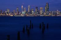 Nighttime view of the Seattle skyline across Elliott Bay from Alki, Seattle, Washington State.