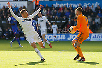(L-R) Connor Roberts of Swansea City moves close to Dean Gerken of Ipswich Town with his arms up during the Sky Bet Championship match between Swansea City and Ipswich Town at the Liberty Stadium, Swansea, Wales, UK. Saturday 06 October 2018