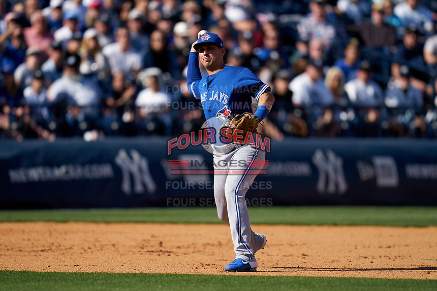 Toronto Blue Jays third baseman Andy Burns (75) throws to first base during a Spring Training game against the New York Yankees on February 22, 2020 at the George M. Steinbrenner Field in Tampa, Florida.  (Mike Janes/Four Seam Images)