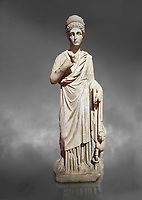 Roman statue of Nemesisgoddess of  retribution. Marble. Perge. 2nd century AD. Inv no 28.23.79. Antalya Archaeology Museum; Turkey. Against a grey background