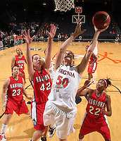 Dec. 6, 2010; Charlottesville, VA, USA; Virginia Cavaliers forward Chelsea Shine (50) shoots the ball in front of Radford Highlanders center Ema Reskoska (42) and Radford Highlanders guard Da'Naria Erwin-Spencer (22) at the John Paul Jones Arena. Virginia won 76-52. Mandatory Credit: Andrew Shurtleff