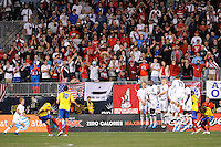 Fans cheer as the USA wall blocks a free kick by Falcao Garcia (9) of Colombia (COL). The men's national teams of the United States (USA) and Colombia (COL) played to a 0-0 tie during an international friendly at PPL Park in Chester, PA, on October 12, 2010.