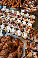 A selection of cakes, croissants and pastries on display in a Baker & Spice cafe
