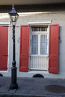 French Quarter, New Orleans, Louisiana.  Window, Shuttered Door, and Lamppost.
