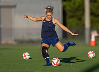 KASHIMA, JAPAN - AUGUST 4: Julie Ertz #8 of the USWNT takes a shot during a training session at the practice field on August 4, 2021 in Kashima, Japan.