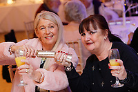 Pictured: Guests raise their glasses during the party. Wednesday 28 November 2018<br /> Re: National Lottery millionaires from south Wales and the south west of England have hosted a glitzy Rat Pack-inspired Christmas party for an older people's music group at The Bear Hotel in Cowbridge, Wales, UK.