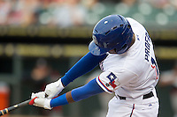 Round Rock second baseman Jurickson Profar (10) swings the bat in the Pacific Coast League baseball game against the Nashville Sounds on May 4, 2013 at the Dell Diamond in Round Rock, Texas. Round Rock defeated Nashville -6. (Andrew Woolley/Four Seam Images).