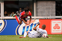 Bryan Ruiz (10) of Costa Rica is fouled by Victor Bernardez (5) of Honduras during a quarterfinal match of the 2011 CONCACAF Gold Cup at the New Meadowlands Stadium in East Rutherford, NJ, on June 18, 2011.