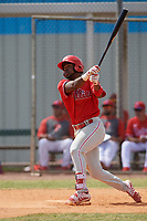 Philadelphia Phillies Kendall Simmons (21) hits a home run during an exhibition game against the Canada Junior National Team on March 11, 2020 at Baseball City in St. Petersburg, Florida.  (Mike Janes/Four Seam Images)