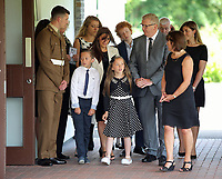 """Pictured: Close family and relatives stand as the coffin of Pat Stewart arrives<br /> Re: The funeral of Pat Stewart at the Cardiff and Glamorgan Memorial Park and Crematorium, Wales, UK. Pat Stewart became famous as """"the girl in the spotty dress"""" after an iconic image taken by Bert Hardy in Blackpool in 1951."""