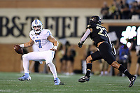 WINSTON-SALEM, NC - SEPTEMBER 13: Sam Howell #7 of the University of North Carolina tries to get away from Justin Strnad #23 of Wake Forest University during a game between University of North Carolina and Wake Forest University at BB