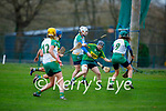 Kerry's full back Sara Murphy been well marshalled by Meath's Tracy King and Kristina King in the Camogie Intermediate Championship