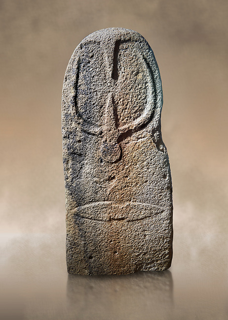 Late European Neolithic prehistoric Menhir standing stone with carvings on its face side. The representation of a stylalised male figure starts at the top with a long nose from which 2 eyebrows arch around the top of the stone. below this is a carving of a falling figure with head at the bottom and 2 curved arms encircling a body above. at the bottom is a carving of a dagger running horizontally across the menhir. Excavated from Bau Carradore II, Laconi. Menhir Museum, Museo della Statuaria Prehistorica in Sardegna, Museum of Prehoistoric Sardinian Statues, Palazzo Aymerich, Laconi, Sardinia, Italy