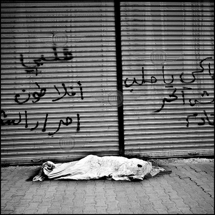 Syria/Aleppo/Aug 30,2012/A dead FSA rebel  outside of   the Dar al-Shifa hospital in Aleppo.Over 60,000 of Syrians have died since the uprising began in March 2011 and  more than 500,000 of Syrian refugees have fled the country to neighboring Turkey,Lebanon,Jordan and Iraq.Giorgos Moutafis